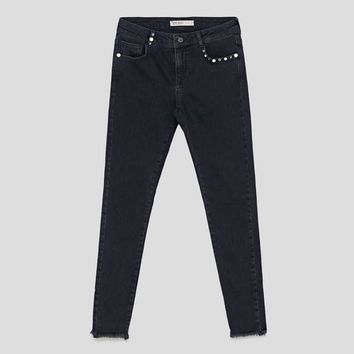 JEANS WITH STUDS AND PEARL BEADS