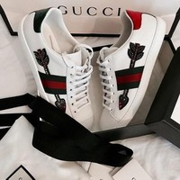 gucci ace arrow embroidered low top sneaker
