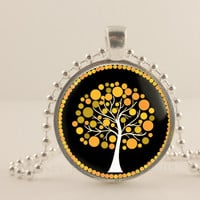 """Yellow and black tree, 1"""" round glass and metal Pendant necklace Jewelry."""