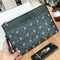COACH New fashion pattern leather couple cosmetic bag handbag file package Black