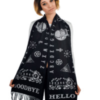 This awesome Ouija print is here to take you away from this cruel, cold world and warm you with it's comfortable scarf powers. And it won't let you down. Knit scarf with knit in Ouija design. Soft fringe on ends.