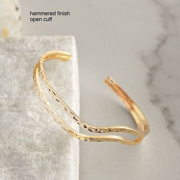 Hammered golden cuff