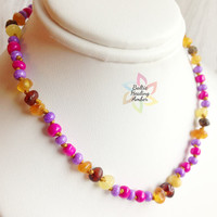 Baby Custom Baltic Healing Amber necklace designed with 100% Baltic amber beads and glass beads in pink and purple colors.