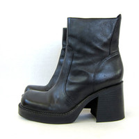 90s vintage black leather boots. tall boots. chunky heel boots. zip up goth boots hipster urban street wear mid calf fashion womens size 8