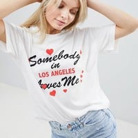 ASOS DESIGN relaxed t-shirt with someone loves me print at asos.com