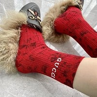 GUCCI soft rubber printed gold socks-2