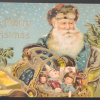 Christmas Postcard of Santa Claus in Blue Robe Driving Car Fully Embossed Gold Post Card