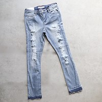 Distressed Cropped Light Denim Skinny Jeans With Frayed Hem