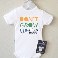 Don't Grow Up, it's a trap Cute Baby Clothes. Cute Baby Shirt. Funny Baby Onesuit. Different Color of Bodysuits Available.