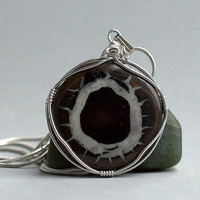 Natural Septarian round pendant silver wire wrapped with a silver plated necklace