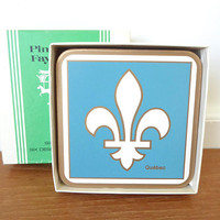 Five Pimpernel Quebec fleur de lis coasters with cork backs in perfect condition, 594 Quebec Embleme