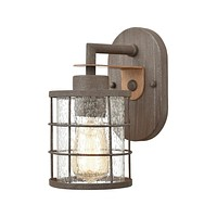 Gilbert 1-Light Vanity Light in Rusted Coffee and Light Wood with Seedy Glass