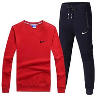 NIKE 2018 autumn new thin round neck long-sleeved T-shirt running sportswear two-piece Red