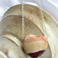 Red and cream gemstone heart pendant and sterling silver necklace.