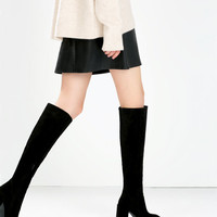 High-heeled leather boot