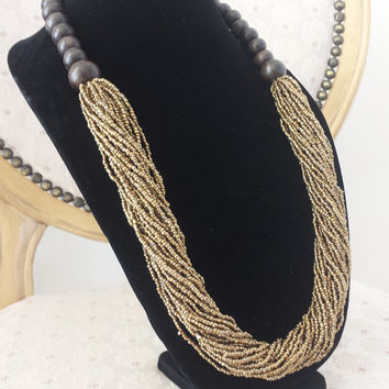 Golden Beaded Boho Necklace Jewelry Womens Gifts at @MystifyGifts #necklace #womensfashion #bohostyle #wishlist #womensaccessories #gifts