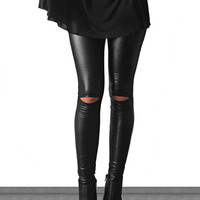 These rock and roll comfy faux leather leggings features high waist design, an elasticized waistband able to fold it down, slit detail at knee, and tapered cut legs. Pair with oversize t-shirt dress and cool booties. Unlined.