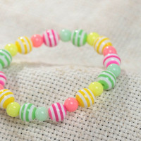 Colorful striped handmade wrist bracelet with plastic beads for girl