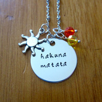 """Disney's """"Lion King"""" Inspired Necklace. Hakuna Matata. Silver colored, Swarovski crystals, for women or girls."""