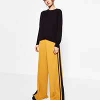 SPORTS TROUSERS WITH SIDE BAND