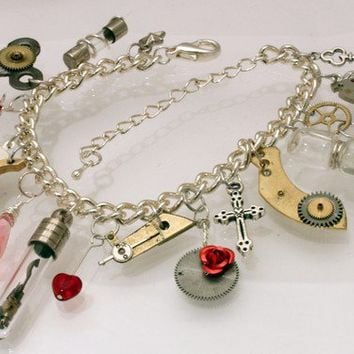 Unique steampunk charm bracelet with glass vial, sand timer and watch part charms- Great for valentines