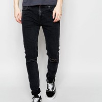 New Look | New Look Super Skinny Fit Jeans in Washed Black with Ripped Knee at ASOS