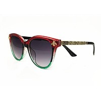 Gucci GG0142SA 003 Red/Gold Round Sunglasses