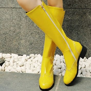 Hot style trend goes with patent-leather low-heeled boots