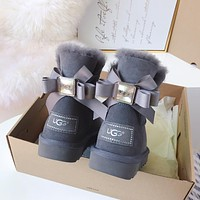 UGG Water drill with multiple layers of ribbon bow tie boots