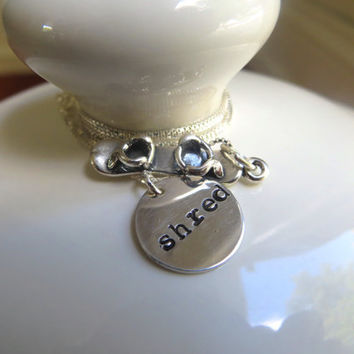 """Silver snowboard necklace with sterling silver hand stamped """"shred"""" charm and silver snowboard charm"""