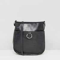 ASOS Leather Vintage Cross Body Bag With Ring Detail at asos.com
