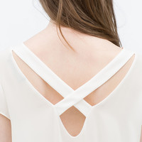 Top with embroidered hem
