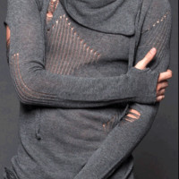 Featuring a shawl neck sweater with adjustable draw string, semi sheer and distressed design, super soft knit fabrication, and finish with asymmetrical bottom hem. For Gal pair with cami, black leather leggings and riding boots. For Guy pair with black ski