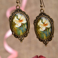 Oval metal designer cute handmade earrings in vintage style with cabochon