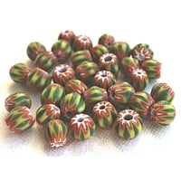 Lot of 25 green and yellow striped chevron glass Beads with a red and white pattern on the ends, approx 6 x 7mm big hole beads C2601