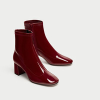 HIGH HEEL FAUX PATENT ANKLE BOOTSDETAILS