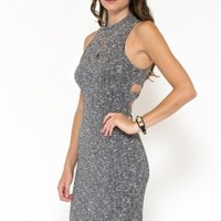This bodycon dress features vertical ribbed knit with back cutout design, sleeveless, mocked turtleneck neckline, and stretchy sculpture fit. Fully lined.