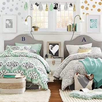 Pastel florals get reimagined in a chic geometric fashion on this soft duvet cover.