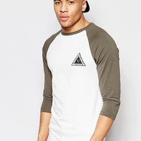 ASOS | ASOS Muscle 3/4 Sleeve T-Shirt With Print And Contrast Raglan at ASOS