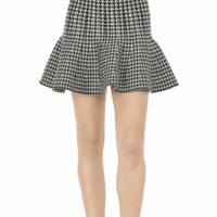 Featuring super soft knit, houndstooth design throughout, slip on style, flare construction. Pair with crop top, leggings and ankle booties.