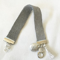 Soft Metallic Stripe Leather Band in Grey with Silver Faceted Bead and Metallic Tassel Size 6-6 3/4 Toggle Clasp in Bright Silver