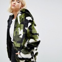 ASOS Oversized Hooded Jacket in Camo Faux Fur at asos.com