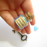 """Disney's Alice in Wonderland """"Drink Me"""" mini bottle pendant necklace/ VIAL necklace with blue glitter/ galaxy/ cosmos/ unicorn/ magic"""