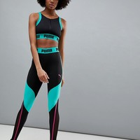 Puma Exclusive To ASOS Zip Up Bra Top &Paneled Legging In Black And Green at asos.com