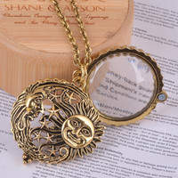 magnifier glass pendant sun with moon and stars necklace antique gold jewelry opens and closes