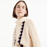 Embellished cable sweater