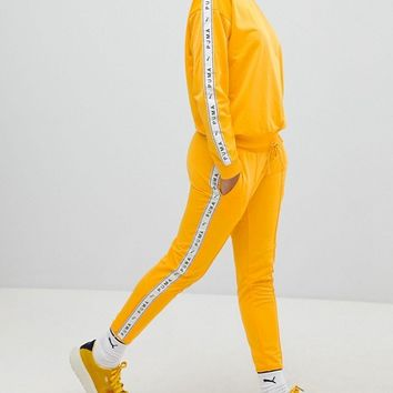 Puma Exclusive To ASOS Taped Side Stripe Track Pants In Yellow at asos.com