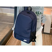NIKE fashion sells casual lady's backpacks in solid color Dark Blue
