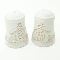 White ceramic / terra cotta salt and pepper shakers