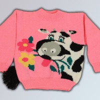 Winter warm knitted children's pink sweater with a cow.  Ready for shipment.
